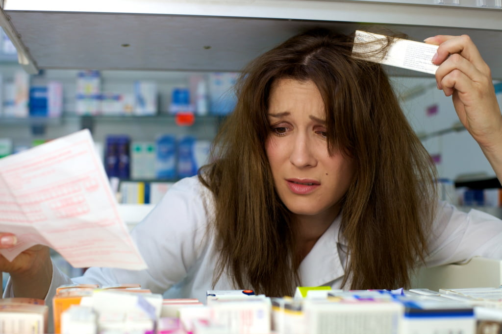 woman pharmacist stressed about not finding medicine