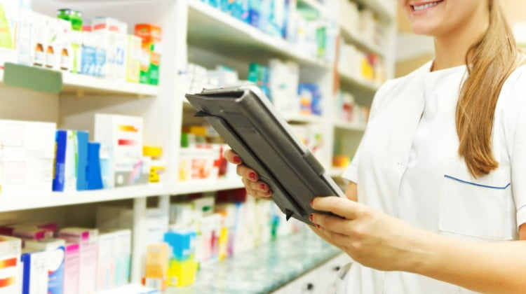 woman looking at pharmacy shelves