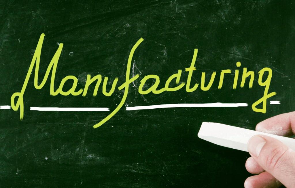 manufacturing is written on a chalkboard