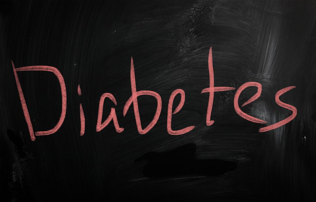 the word diabetes is written on a chalkboard