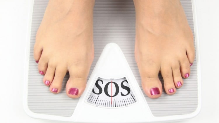 "obesity: feet on scales, which say ""SOS"""