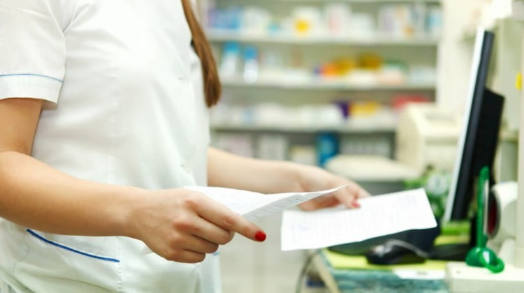 Advanced Practice Pharmacists pilot: pharmacist with script in dispensary