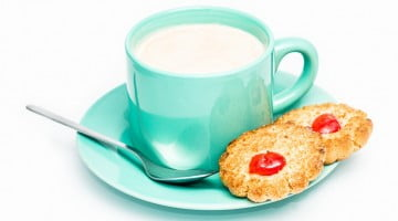 teal coffee cup with biscuits
