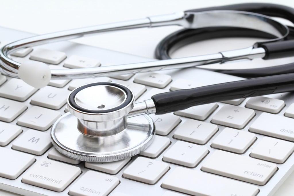 stethoscope on computer keyboard