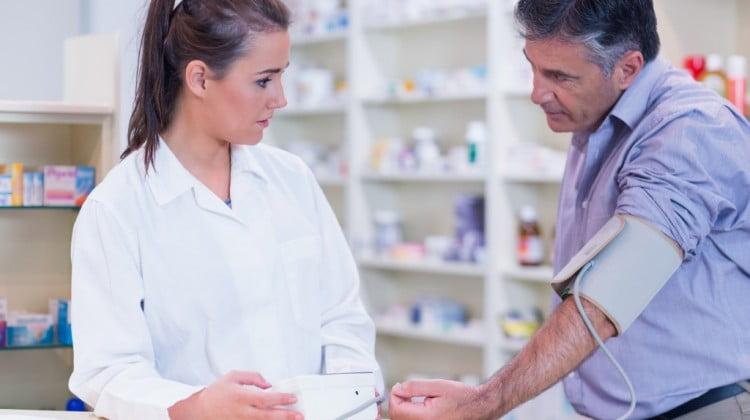 pharmacist doing blood pressure check