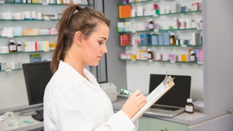 woman pharmacist writing on a piece of paper