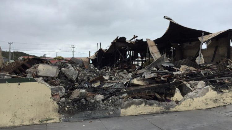 Rubble: the King Island pharmacy will rebulid, says owners