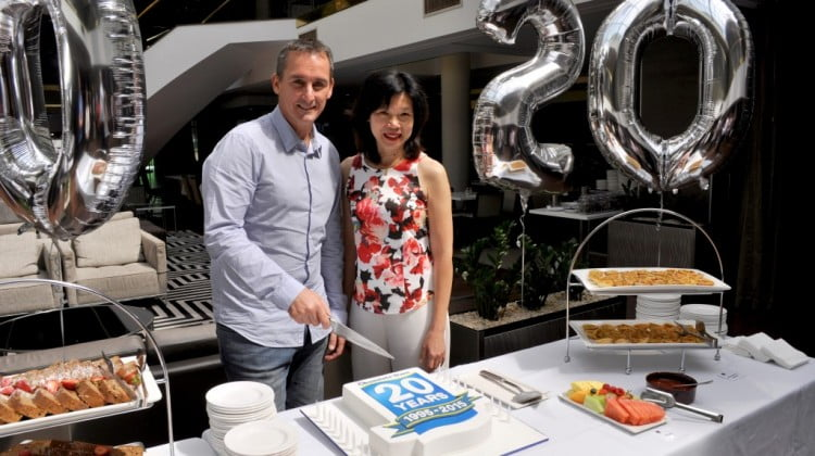 Wayne Marinoff Head of Generics Aspen Australia and Liz Jordan Senior Brand Manager – Chemists' Own prepare to cut the birthday cake at Chemists Own 20th birthday celebration.
