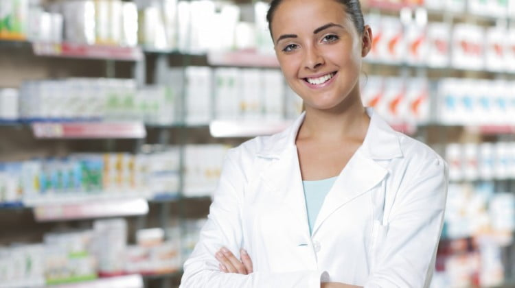 happy pharmacist smiling in dispensary