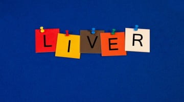 "liver cancer: ""liver"" spelled out on post-its hanging from line"