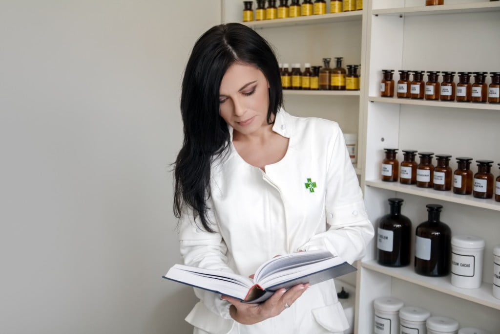 Australian Pharmaceutical Formulary (woman reading book in dispensary)