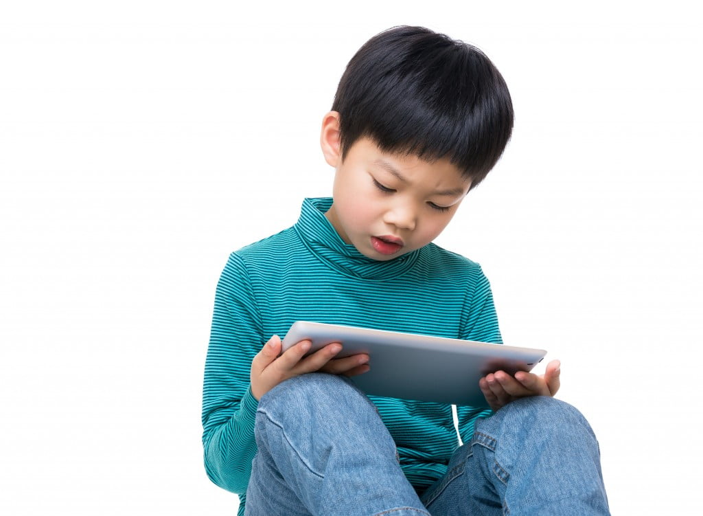 child using electronic devices