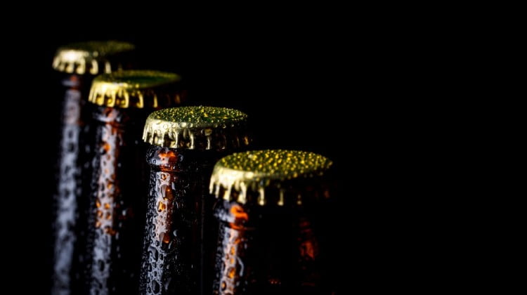 liquor outlets: beer bottles in a row