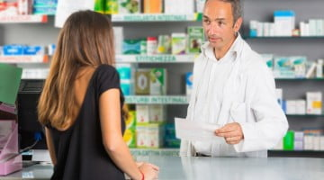 closing the gap: pharmacist talks to customer