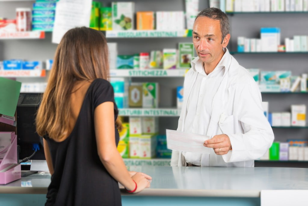 closing the gap: pharmacist talks to customer