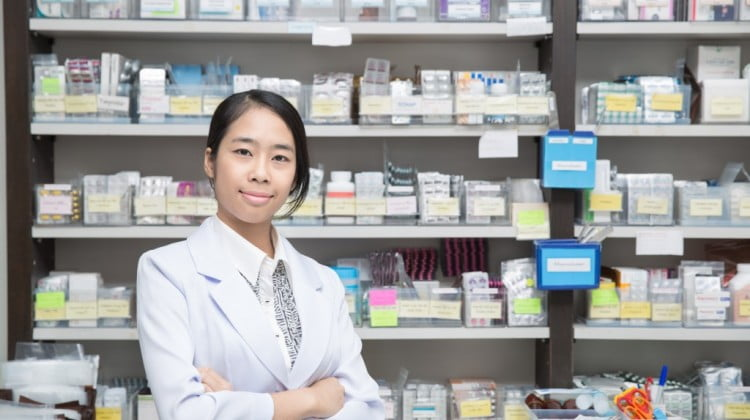 happy pharmacist in dispensary