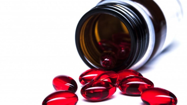 complementary medicines spill out of bottle