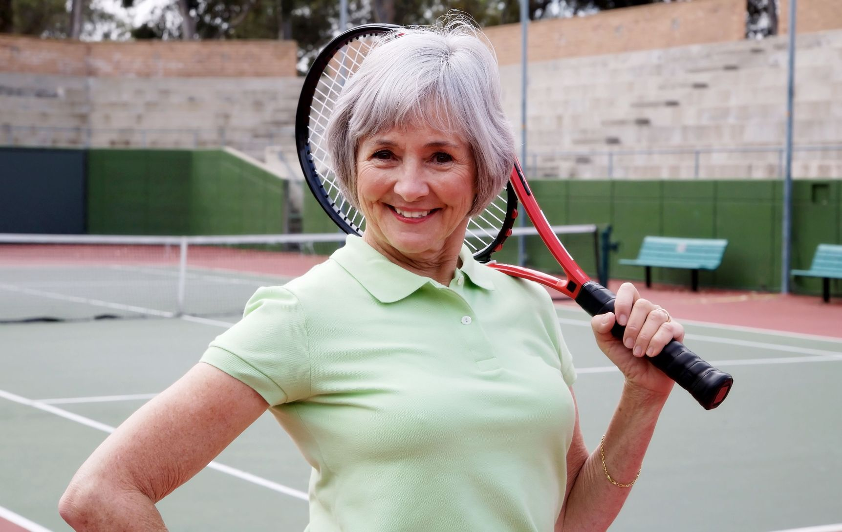 elderly woman with tennis racket