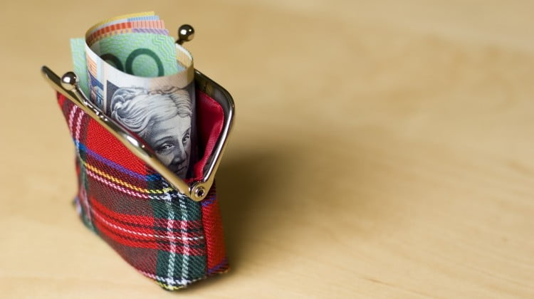 cash sticking out of coin purse