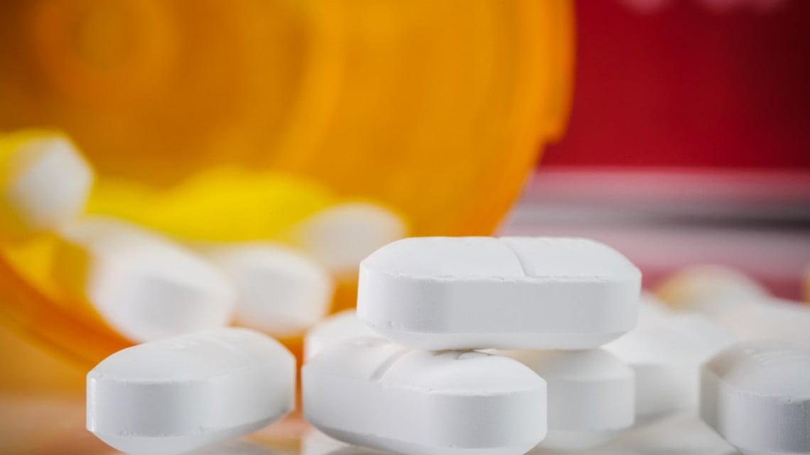 codeine tabsules spill from orange pill bottle