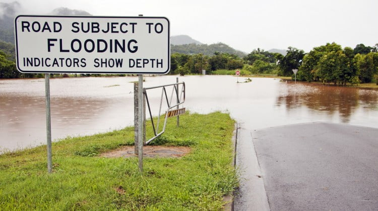 mould risk: flood sign by flooded road