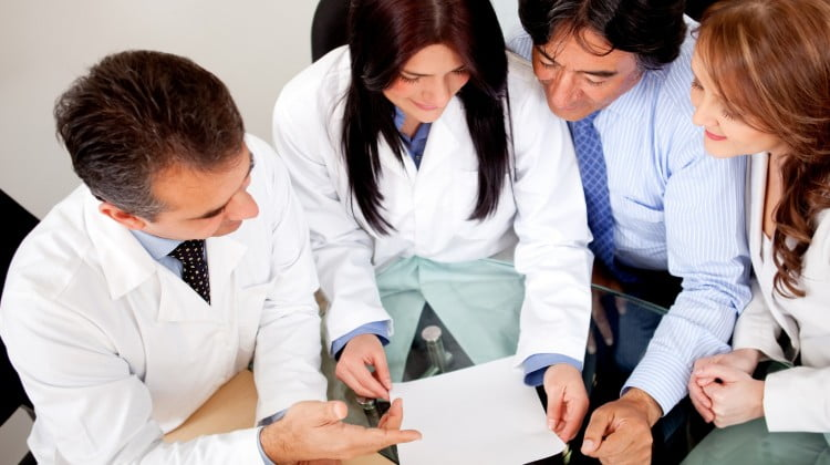Four pharmacists collaborating: Harper Review