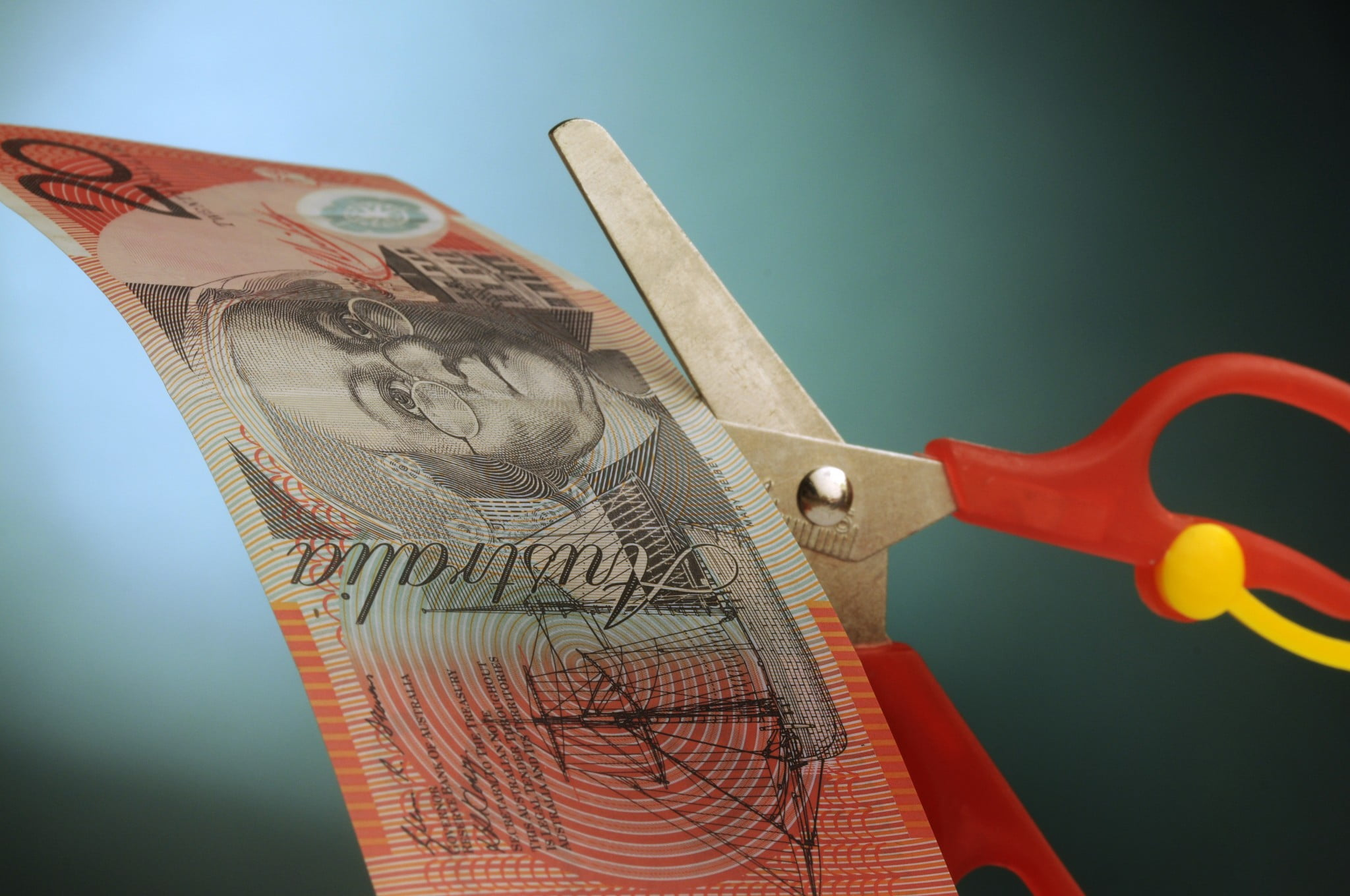 PBS cuts: scissors snipping $20 note