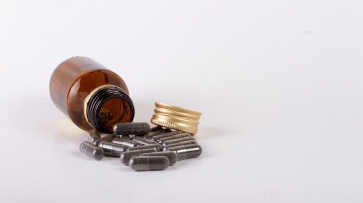 CMA: complementary capsules spill out of bottle