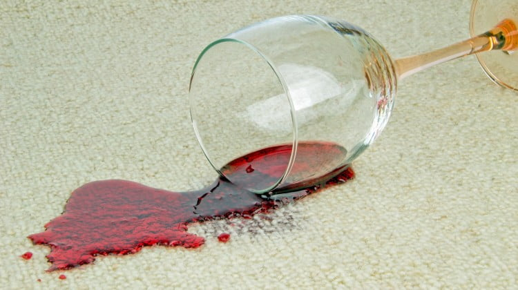 drug treatments: red wine spills from glass onto beige carpet