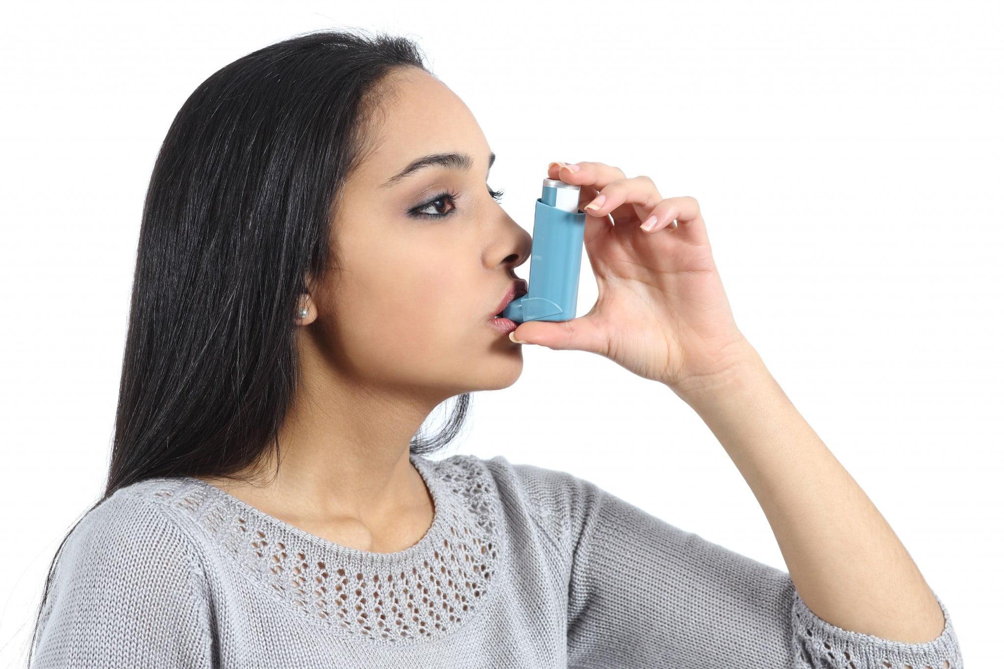 National Asthma Handbook launch: woman uses inhaler