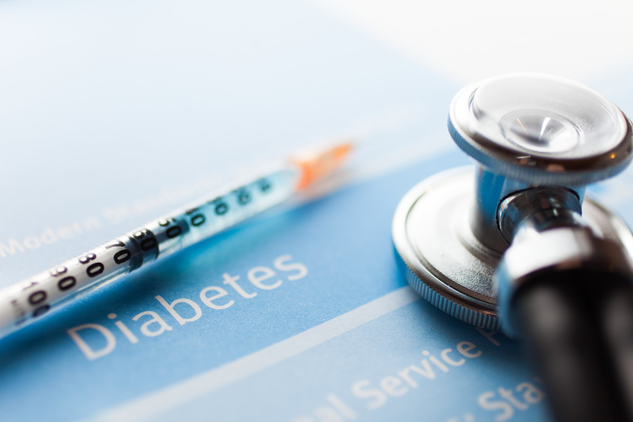 "Type-2 diabetes concept: stethoscope and syringe on the word ""diabetes"""
