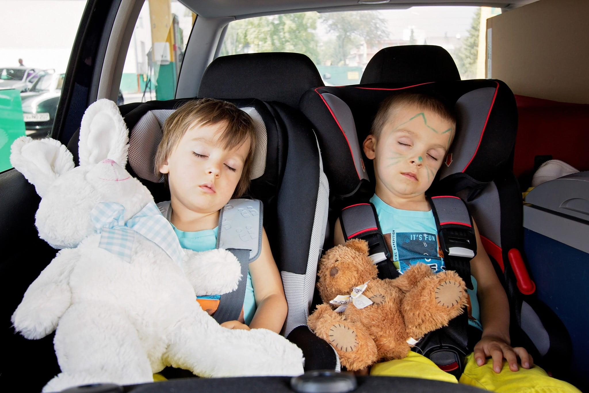 sedating antihistamines: two boys asleep in the back seat of a car