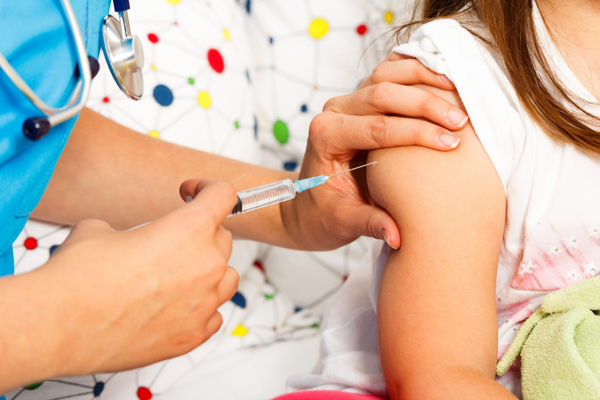 vaccine refusal: jab goes into child's arm