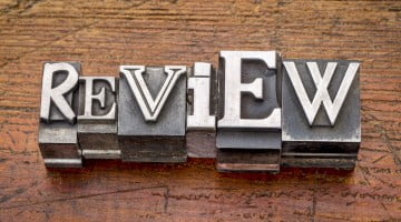 "Word ""review"" in metal type"
