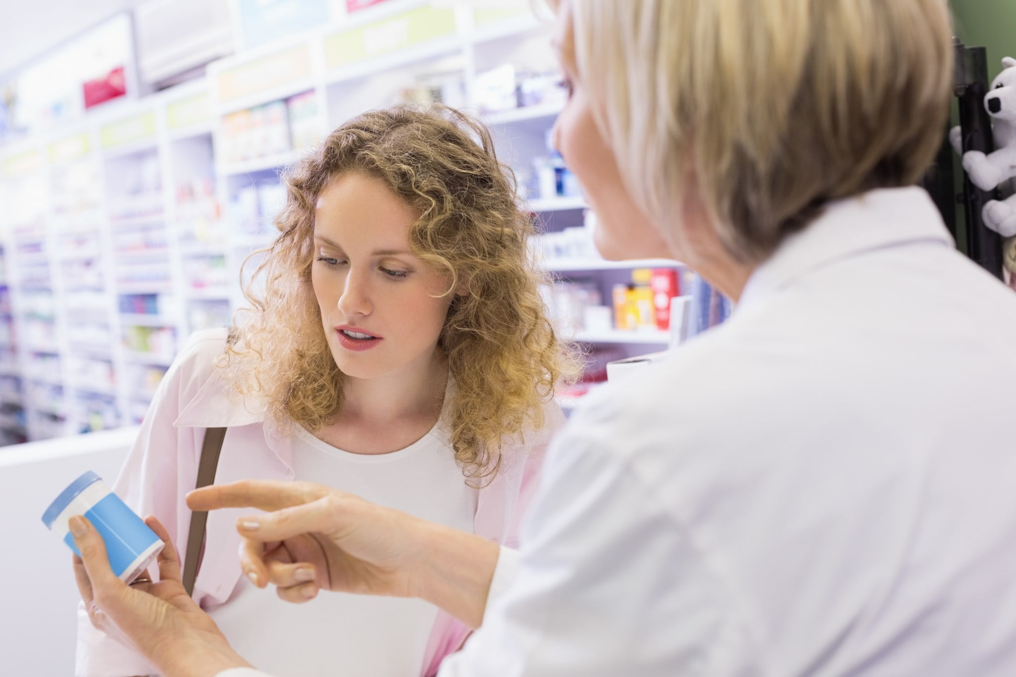 pharmacist services: pharmacist explains medication to female customer