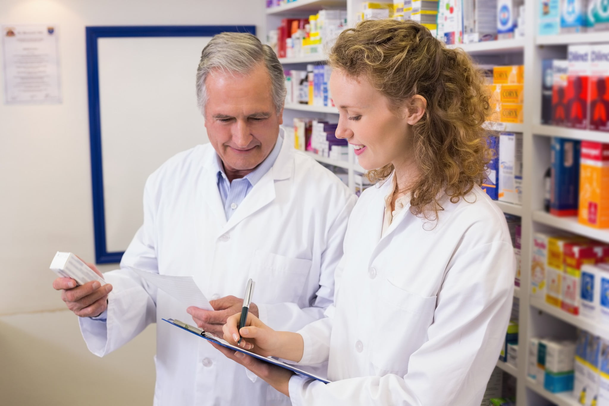 two pharmacists talking in dispensary