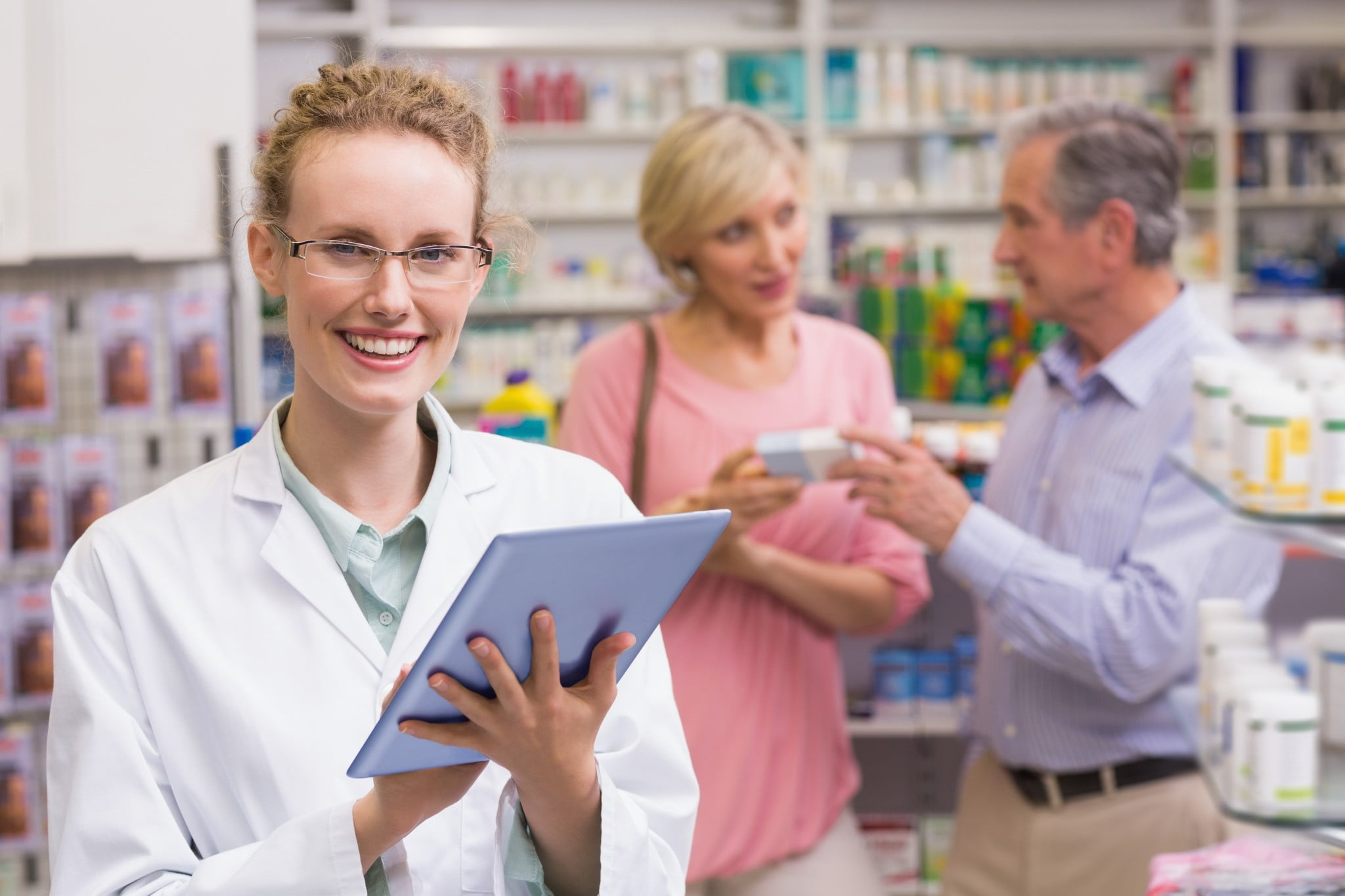 pharmacist with tablet computer