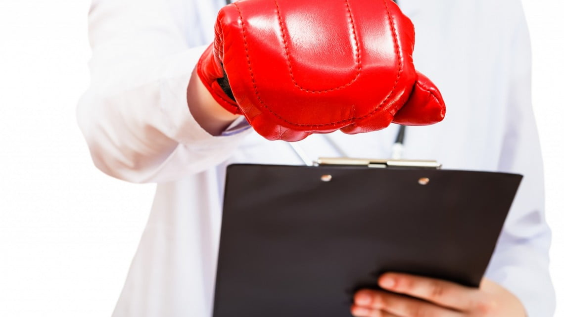 doctor wearing boxing glove