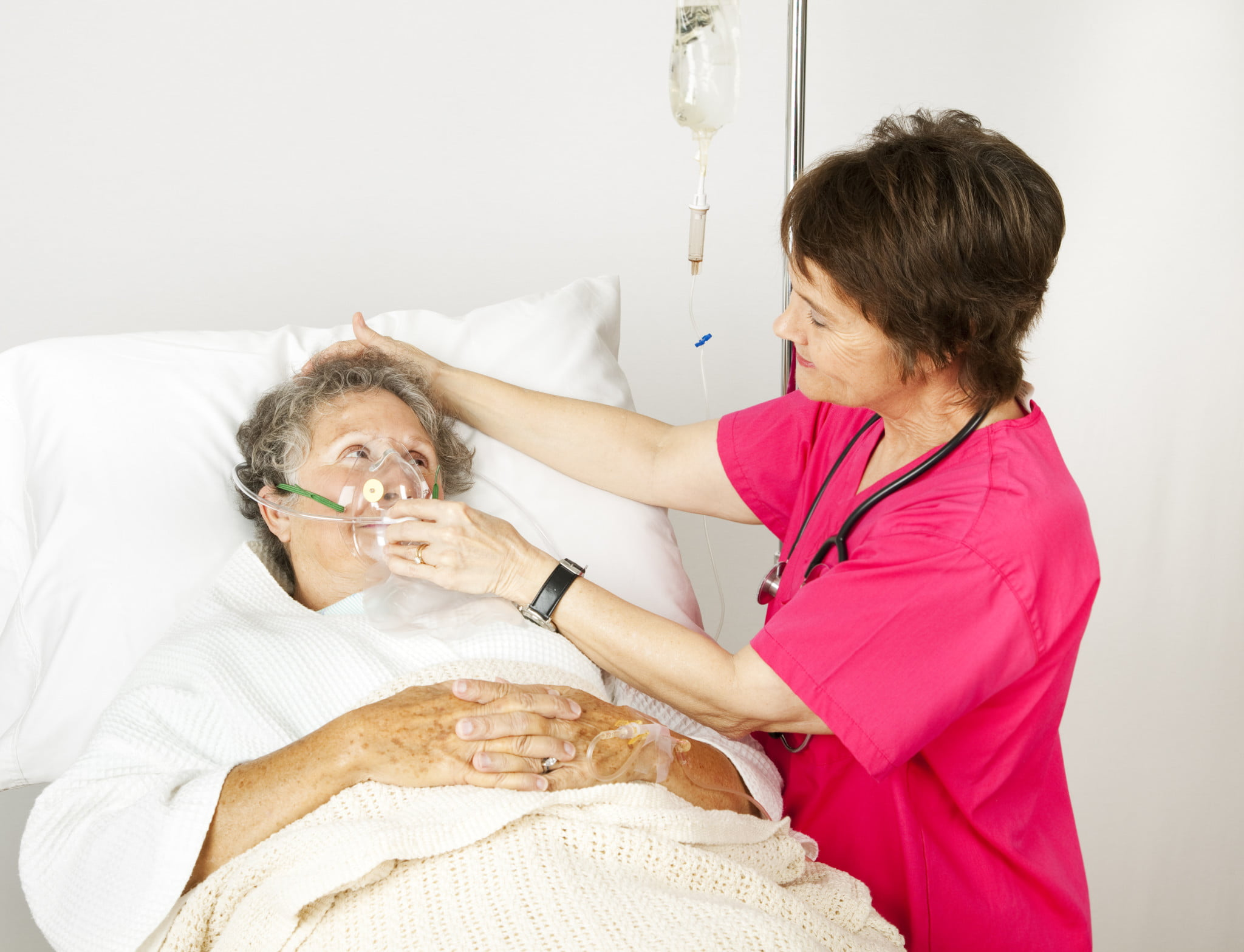 woman with asthma in hospital bed with nurse