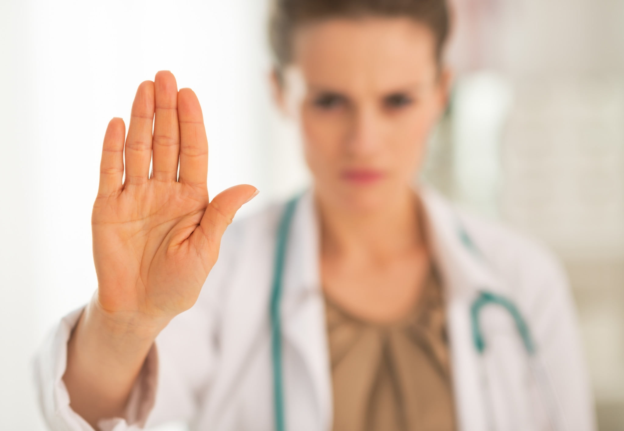 "doctor makes ""stop"" gesture with hand - ama"