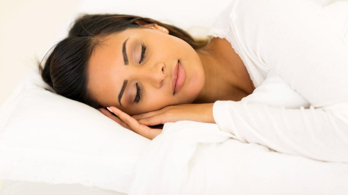 sleep health: woman asleep on her side