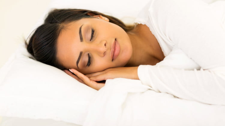 sleep health: woman asleep on her side