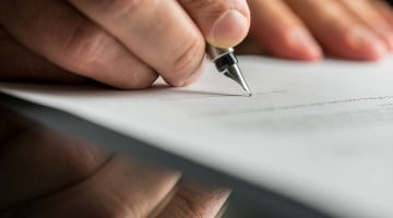 signing document - Sixth Community Pharmacy Agreement