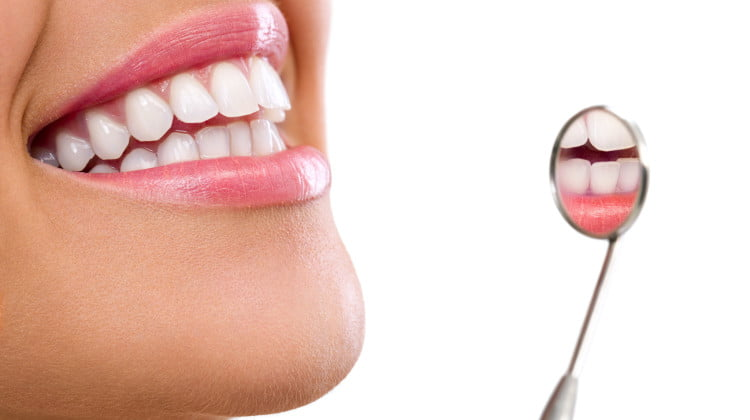 Budget 2015: closeup of mouth and dental mirror