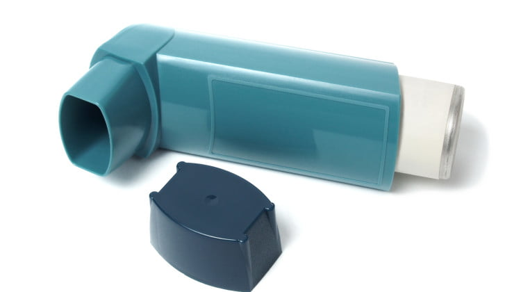 asthma reliever puffer on its side