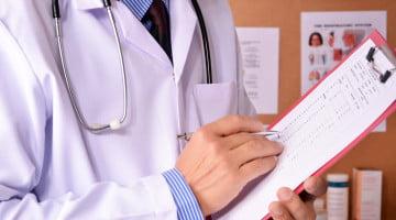 choosing wisely: doctor writes on clipboard