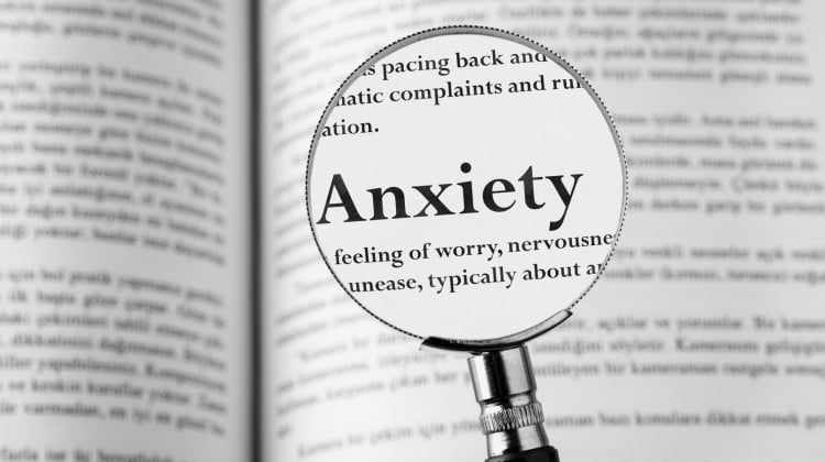 """magnifying glass over the word """"anxiety"""""""