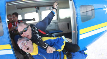Guild president George Tambassis skydives to raise brain cancer awareness