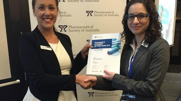 Shanae Hancey receives her award