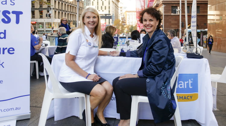 Chemmart Pharmacist Carolyn Wynen taking the blood pressure of National Stroke Foundation Chief Executive Officer Dr Erin Lalor as part of Australia's Biggest Blood Pressure Check.